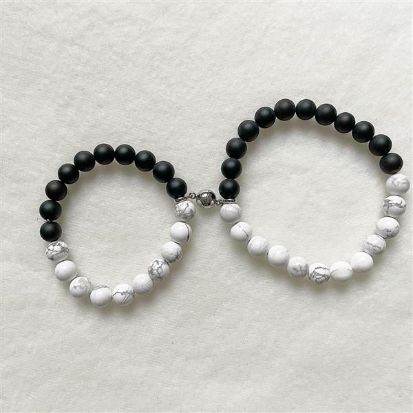 Mágneses páros karkötő fekete fehér
